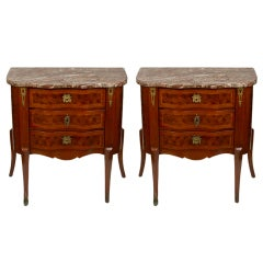 A pair of French Louis XV style three drawer tables