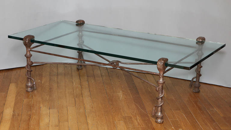 A patinated forged iron coffee table in the manner of Giacometti. The