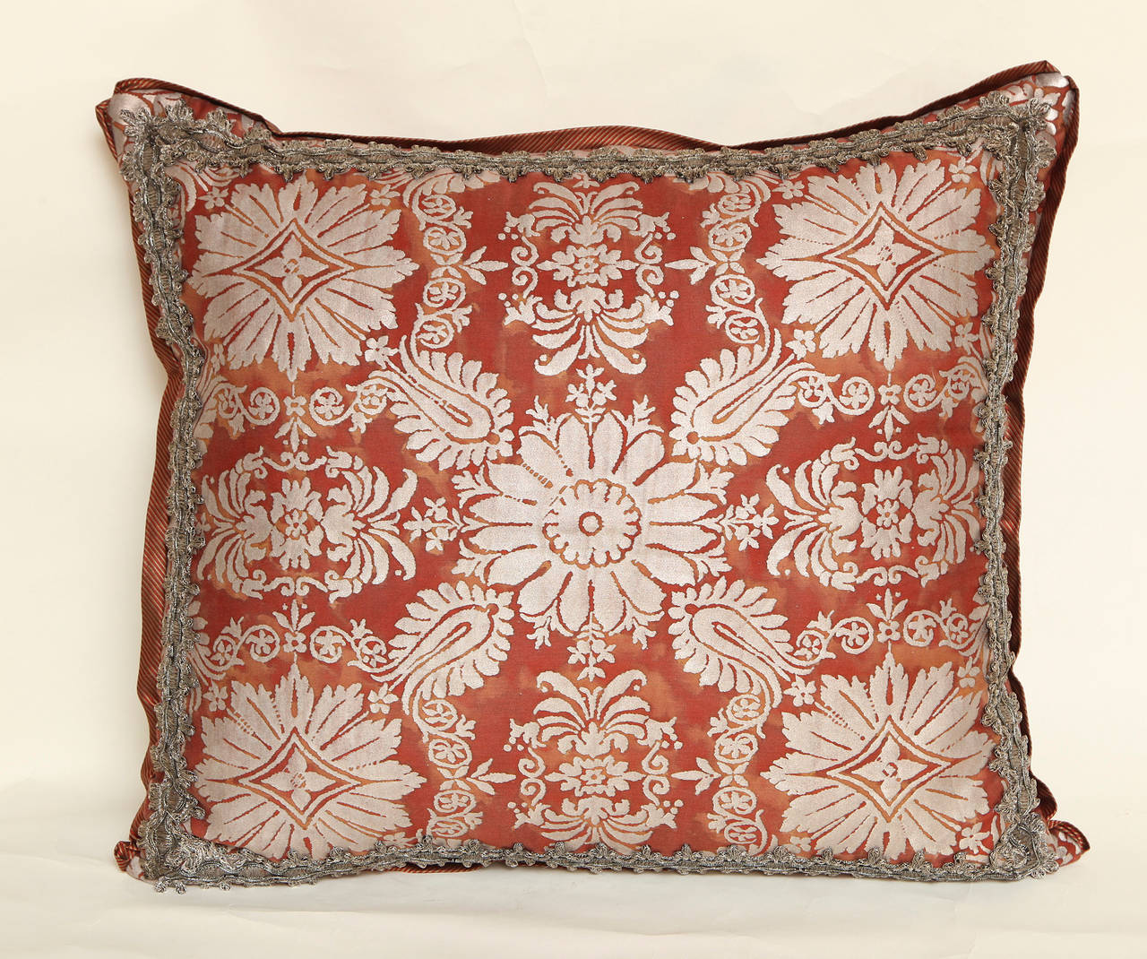 A Fortuny fabric red and silvery gold Impero pattern cushion with handmade metallic lace gallon border, pinstriped silk bias edging, and matching back. Newly made using vintage Fortuny fabric, circa 1940