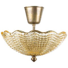 A Swedish Orrefors Ceiling Fixture with Light Amber Colored Molded Glass
