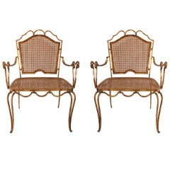 Pair of Arturo Pani gilt over iron and caned chairs