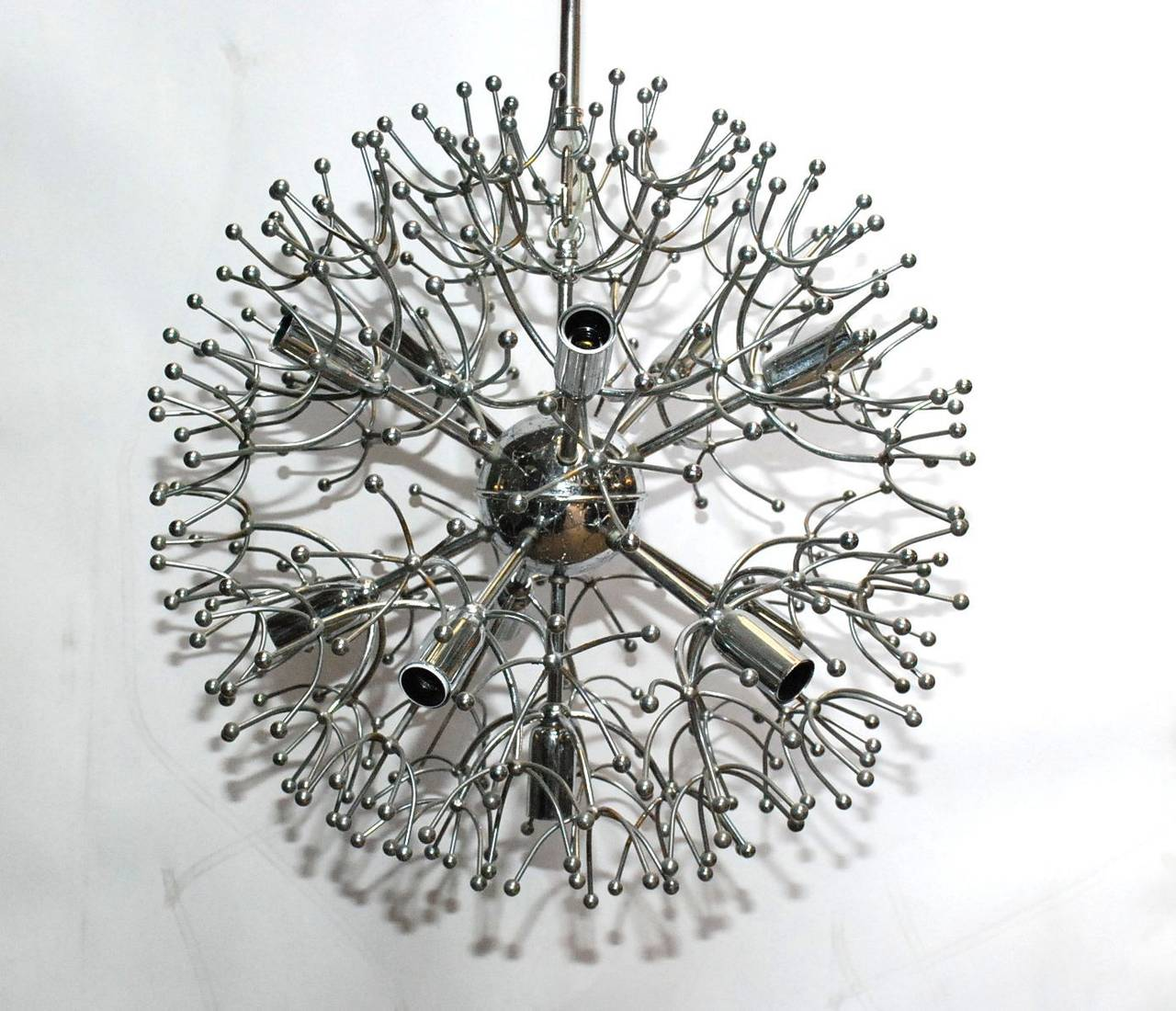 A Sciolari chrome sputnik chandelier with 11-light sockets. Diameter of the fixture is 18