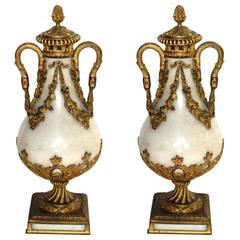 Pair of Louis XVI Style Bronze-Mounted Carrara Marble Urn-Form Garnitures