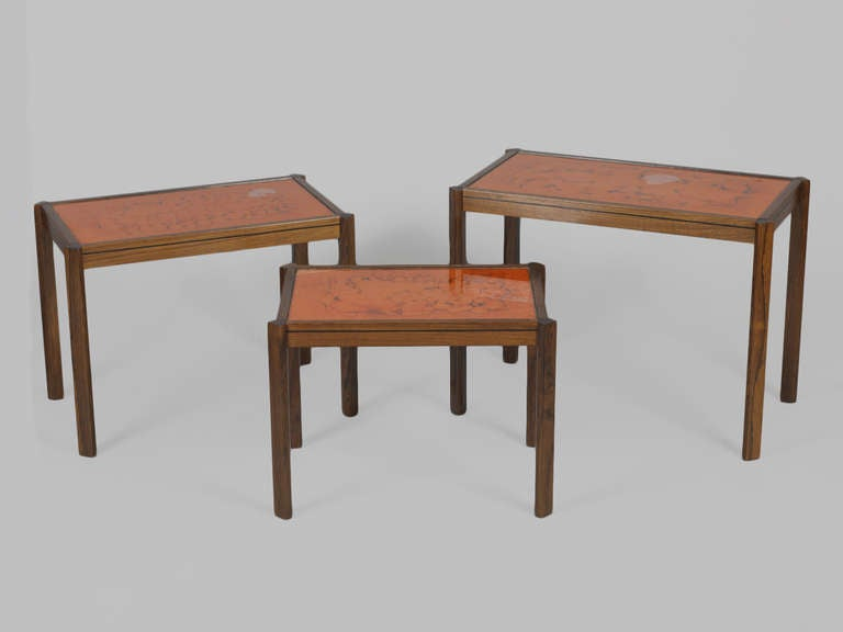 Rosewood nesting tables with painted orange glass top at for Glass top nesting tables
