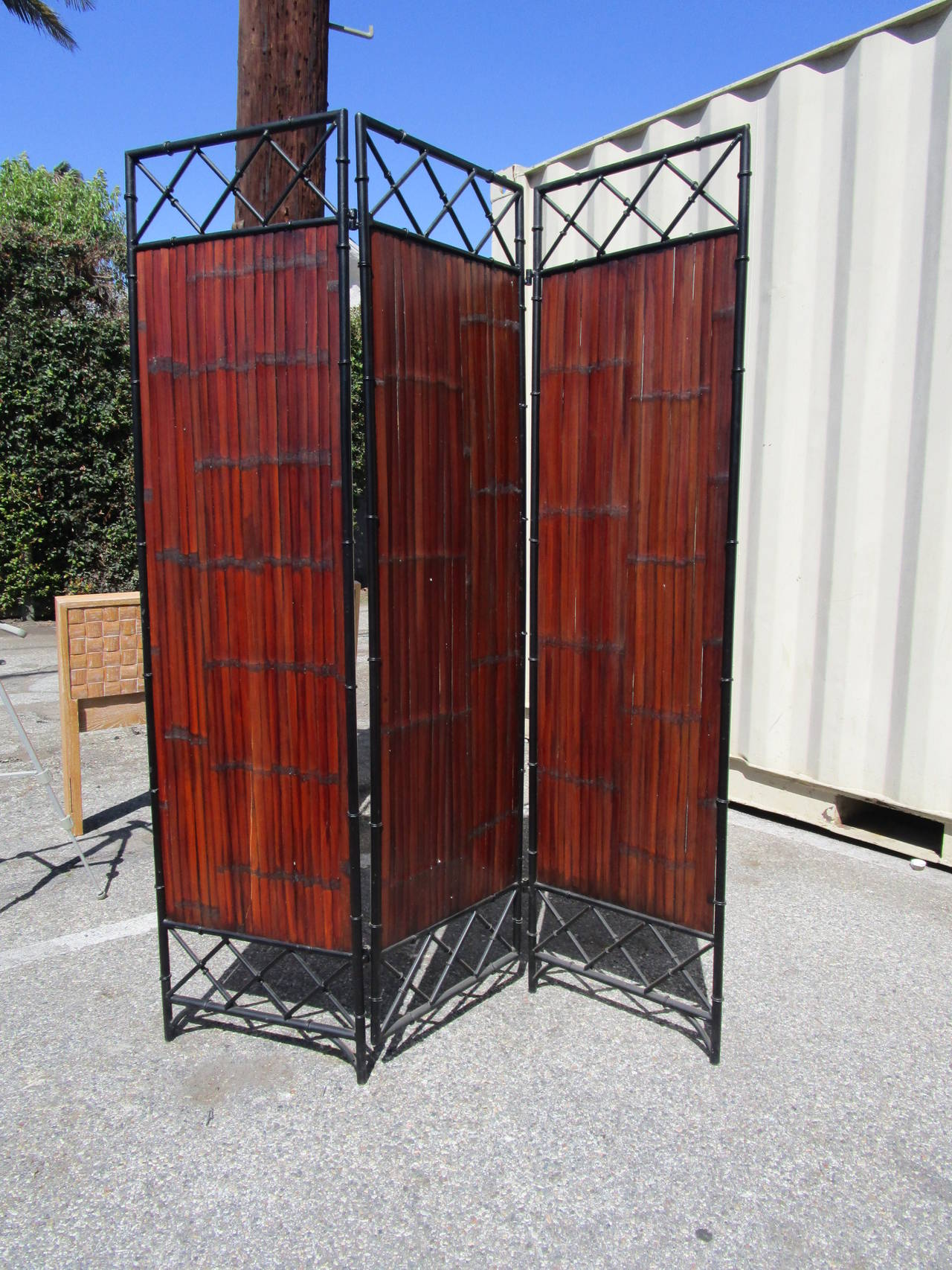 A sturdy, classic 3 panel wrought iron and bamboo slat screen. The bamboo slats have a rich, mahogany finish.