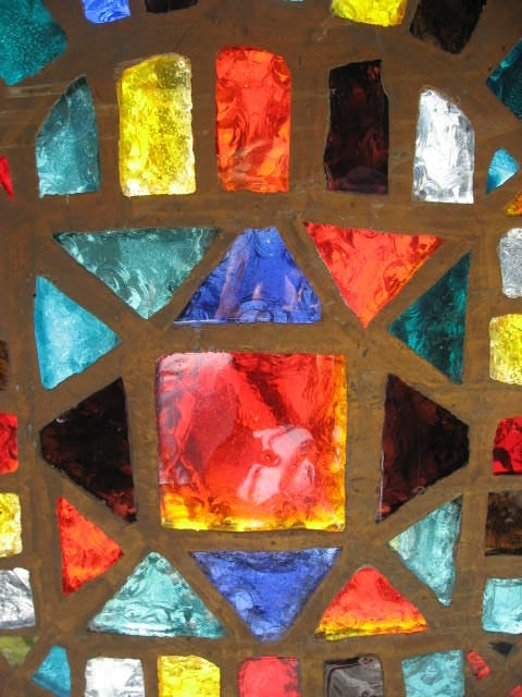 Salvaged stained glass windows in a colorful sixties palette. Would add a beautiful pop of color to any architecture. It could also be hung like art pieces or be a table top.
