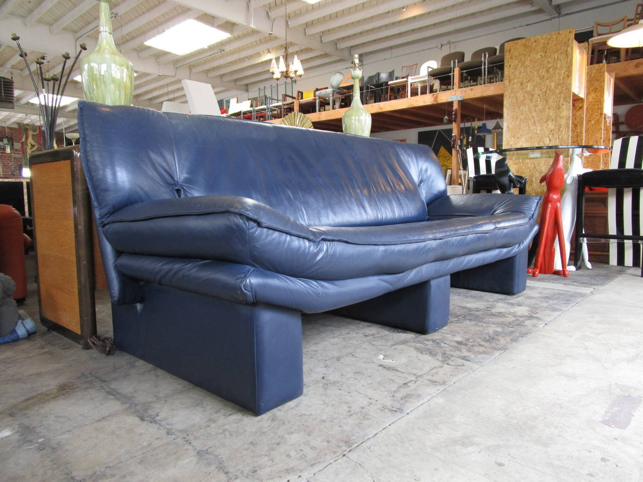 Blue Leather Sofa On Three Supports Entirely Clad In Strong Lines And Very