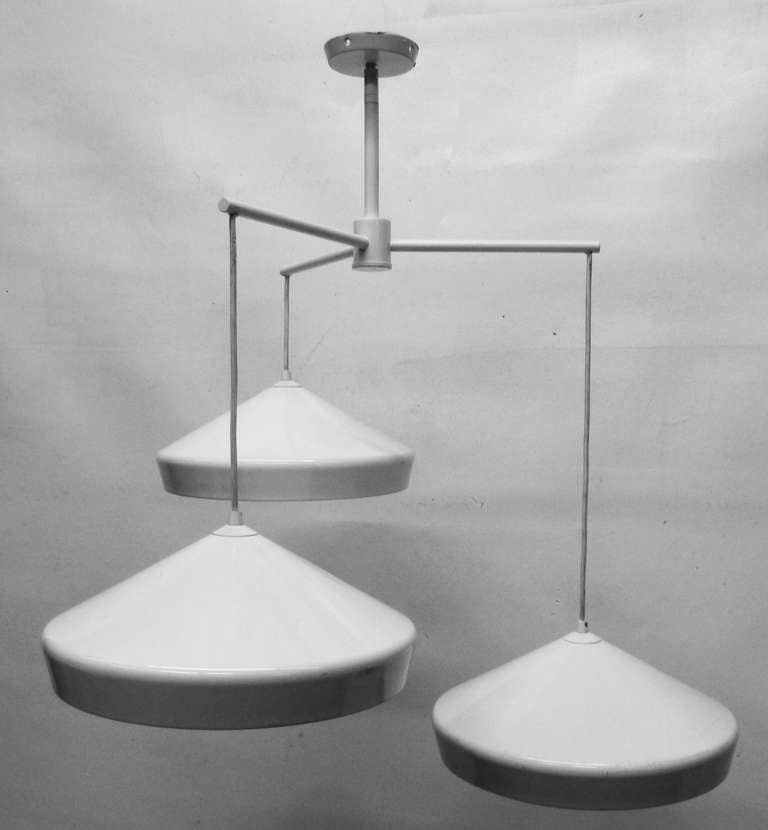 this unusual pendant light with three tiered fixtures is no longer