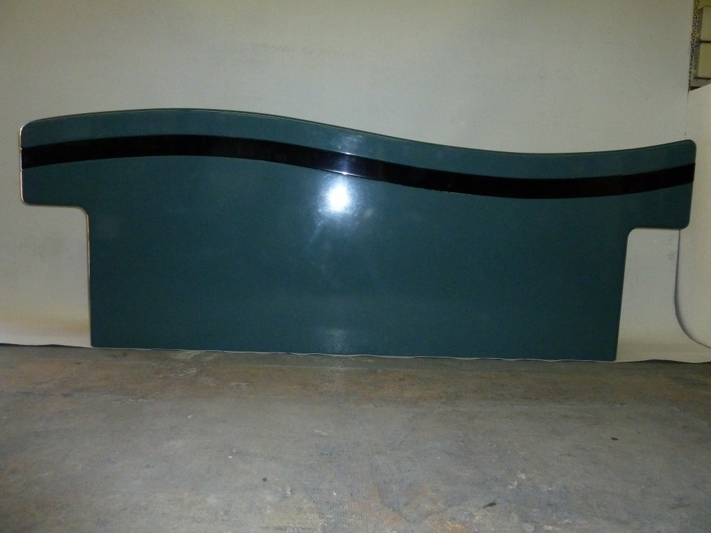 The undulating top of this lacquered teal headboard by Rougier is further delineated by a black band that runs the course of the top edge. This listing is for the headboard only. It is designed for a king size bed. Please see our matching Rougier