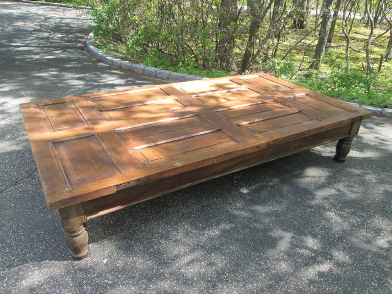 Grand mahogany door converted into a coffee table. Classic turned legs, could be used with or without glass