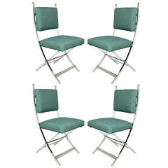 Set of Four Polished Aluminum Campaign Chairs