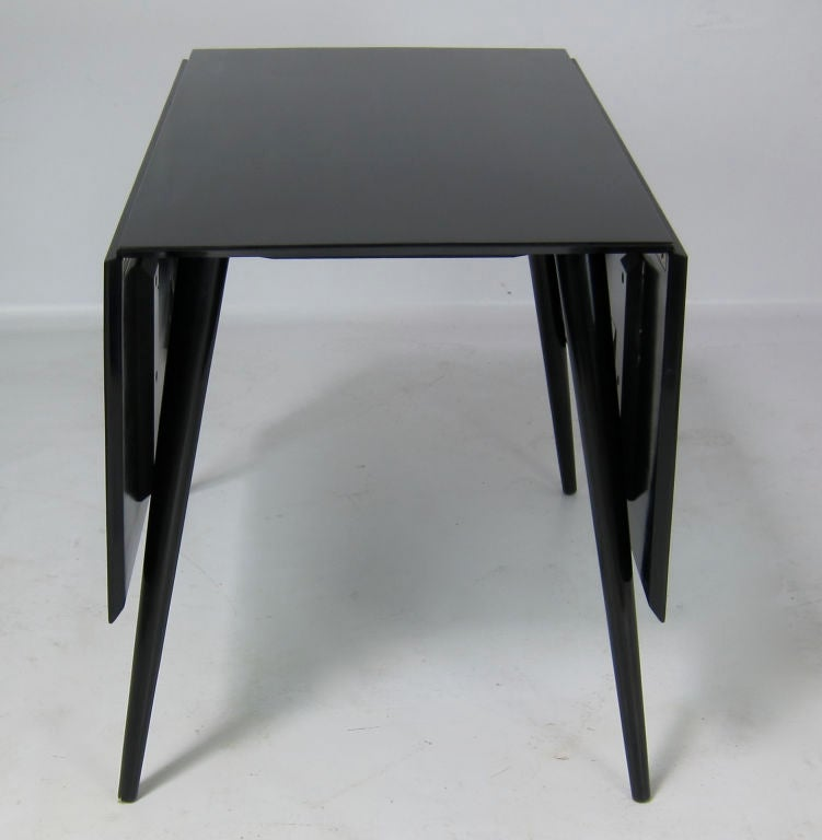 this black lacquer dropleaf dining table by paul mccobb is no longer