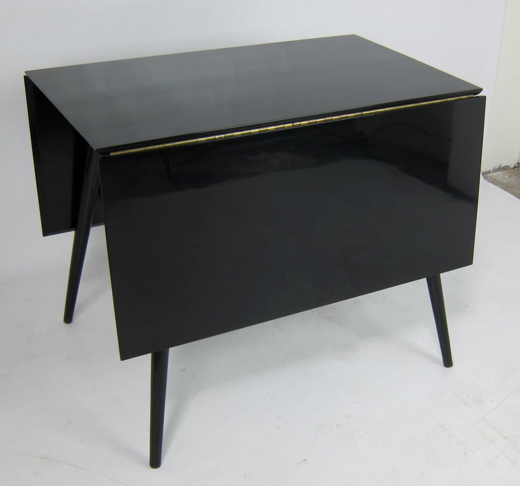 Black lacquer dropleaf dining table by paul mccobb at 1stdibs for Black dining table