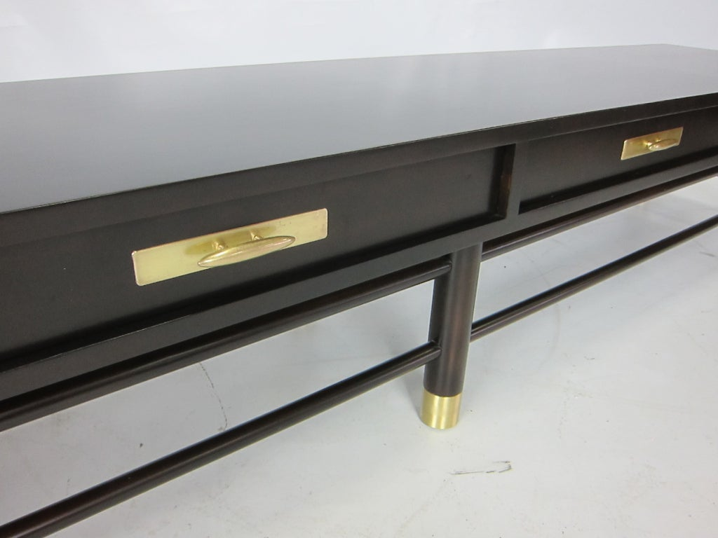 Long Low Bench in the Bel Air Modern style on heavy dowel legs with double stretchers and brass ferrules.  Four functioning drawers with brass hardware.  Freshly refinished in Vandyke Brown Lacquer.  The seat would work beautifully with a fitted