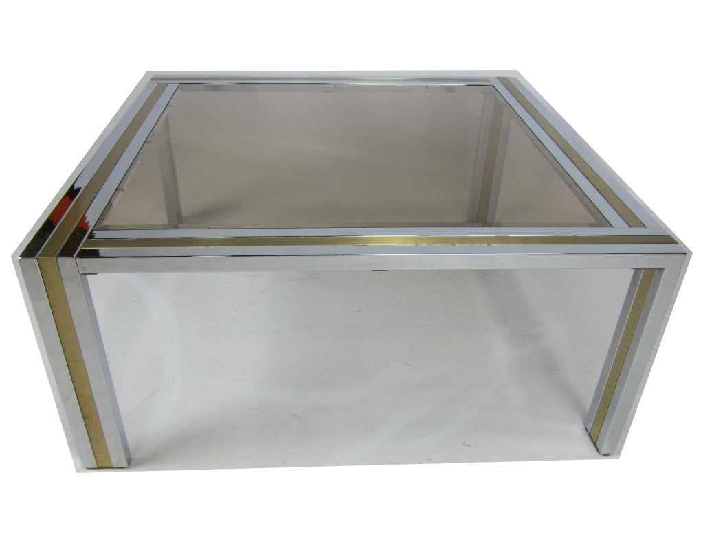 Finely crafted Chrome and Brushed Brass Cocktail Table with smoked and beveled glass top.  Please browse our entire inventory at www.antiquesdumonde.1stdibs.com