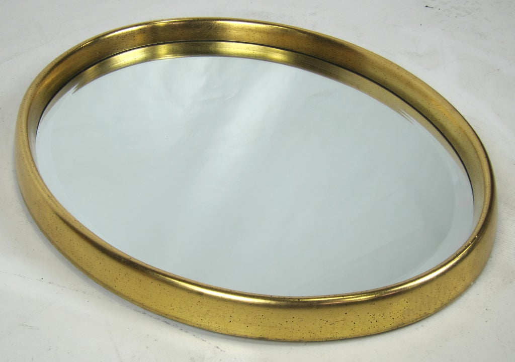 Deep Oval gilt mirror.  Beveled glass.  Please browse our entire inventory at www.antiquesdumonde.1stdibs.com