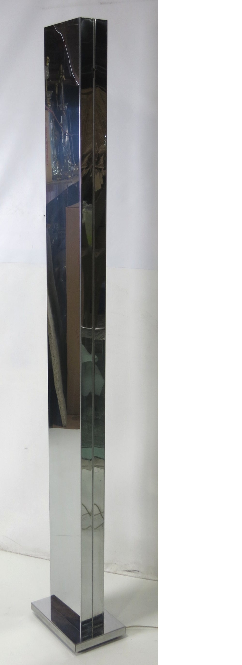 Pair of chrome monolith torchieres by the venerable Casella Lighting of San Francisco. The pair is in excellent original condition.