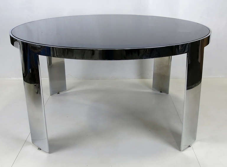 Large-scale dining or center table with inset polyester lacquer top from the Custom Collection by Pace. The table is constructed of heavy gauge steel and nickel-plated with height adjustable glides. The legs are 8