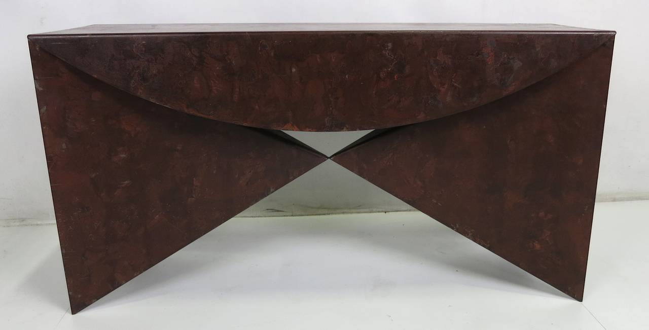 Wonderful studio crafted pair of patinated steel consoles constructed of one piece of folded steel plate with a mottled bronze finish in the style of Neal Small.