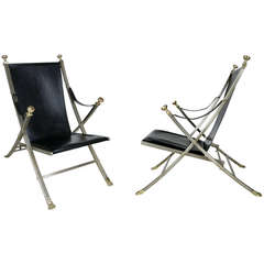 Pair of Steel and Brass Campaign Chairs by Maison Jansen