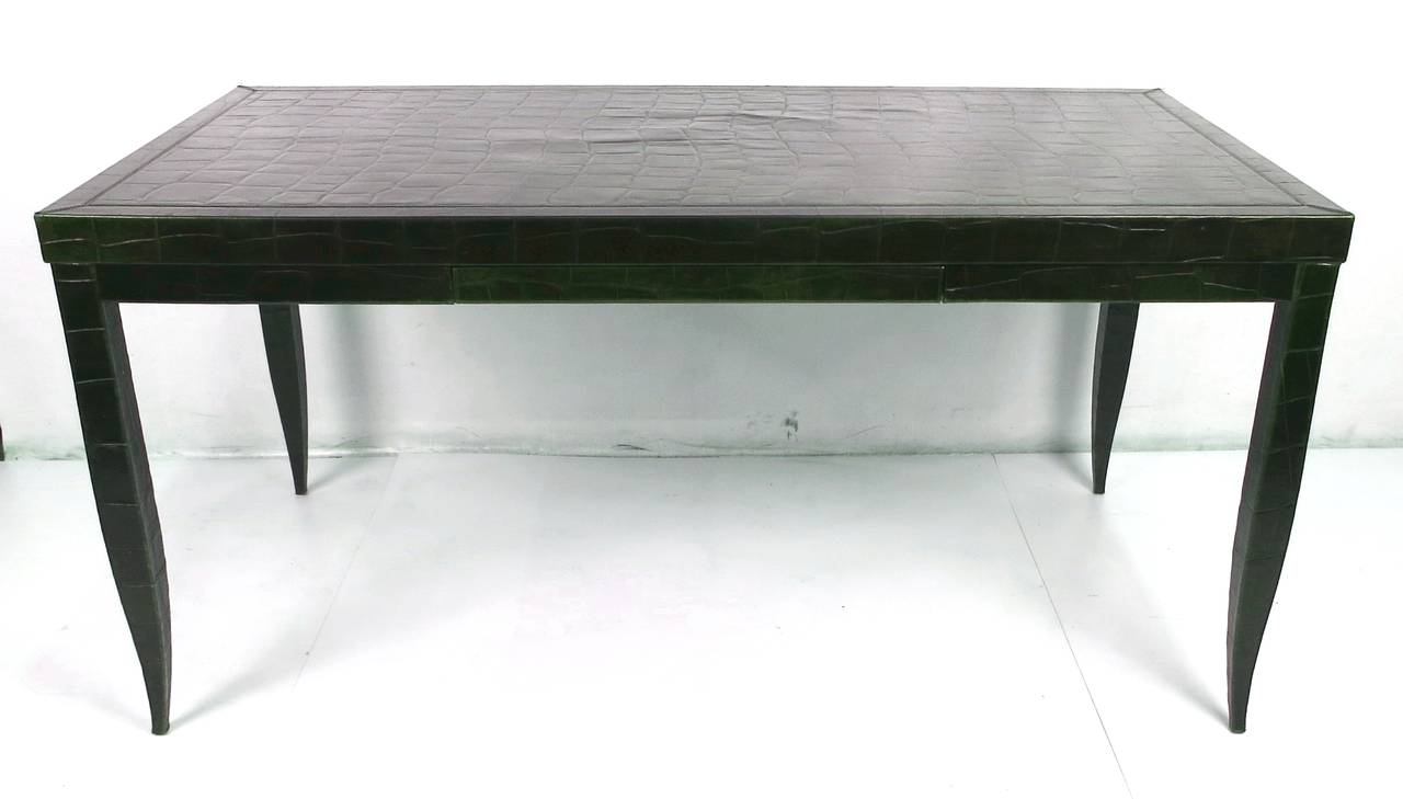 Gorgeous Alligator embossed leather clad desk by Élitis for Armani Casa. The Bureau Plat with its sinuous tapered cabriole legs is fully clad in saddle stitched alligator embossed leather and has a slim pencil drawer in the apron.  Top quality