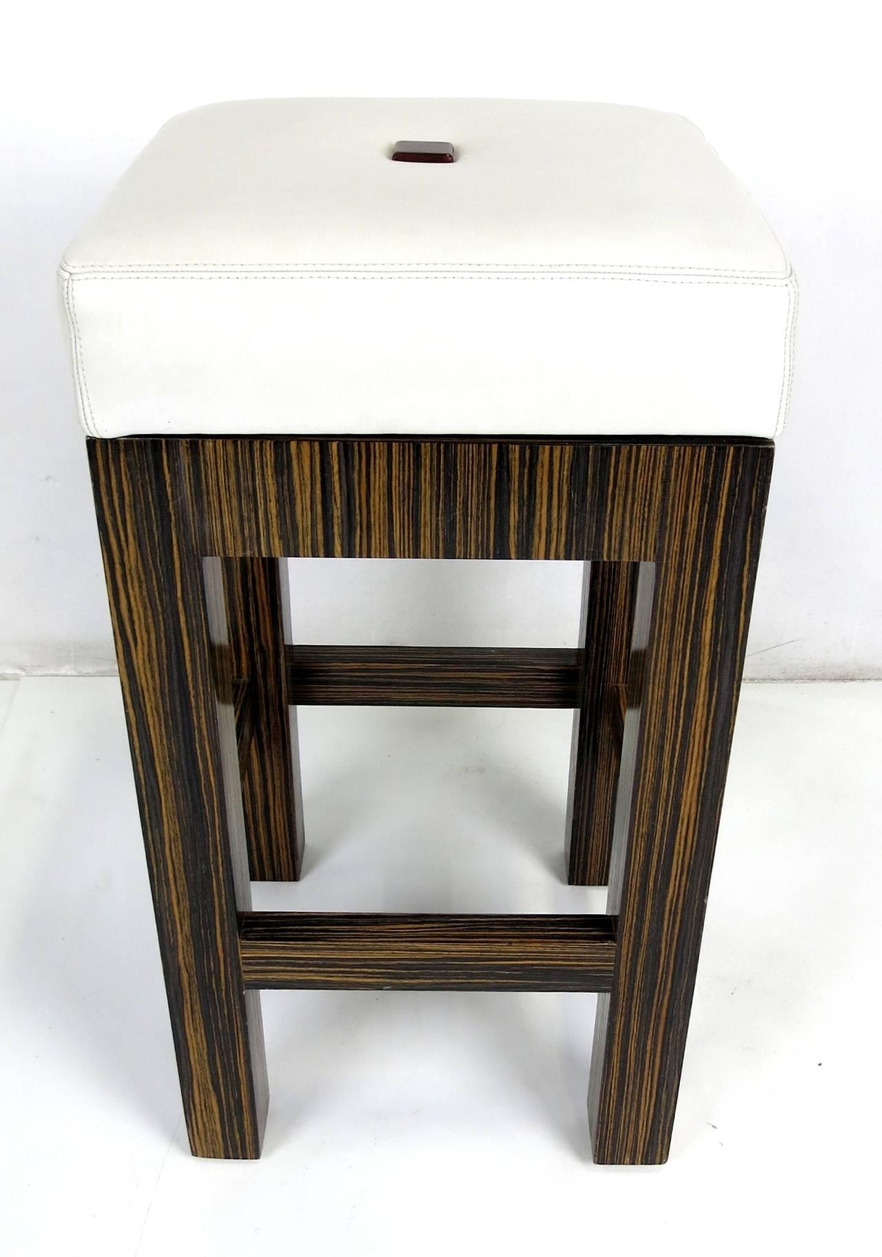 Set of Three Macassar Ebony Swiveling Bar Stools with Leather Seats