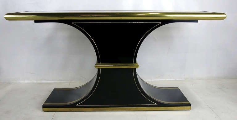 Sophisticated black lacquer console with brass trim in the inimitable style of Mastercraft. Finest quality materials and craftsmanship.
