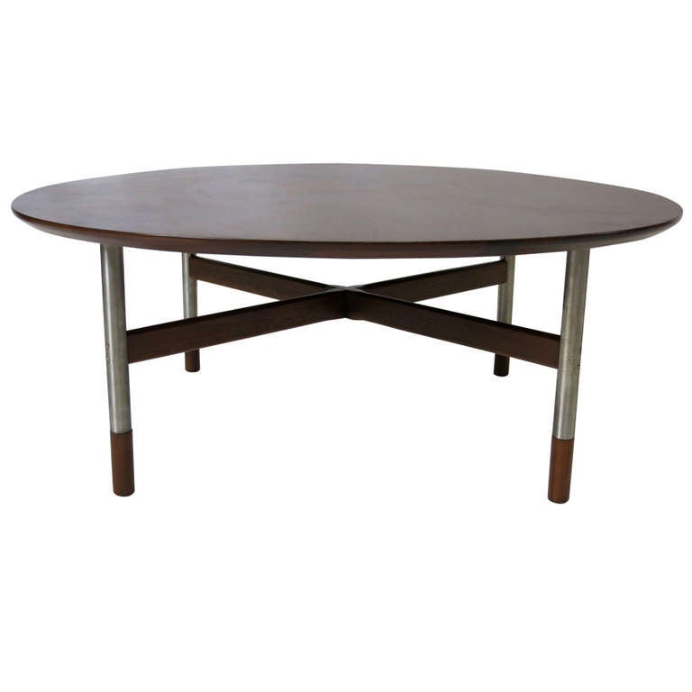 walnut coffee table with stainless steel legs by arne