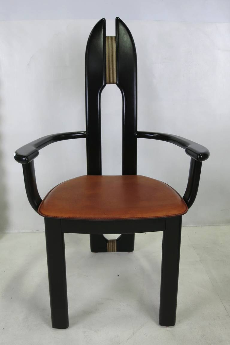 Set of Six Sculptural Italian Armchairs.  The solid wood chairs have been restored from the ground up and refinished in Espresso Lacquer.  The splats are connected by a contrasting panel of solid laminated hardwoods.  The seats are natural Saddle