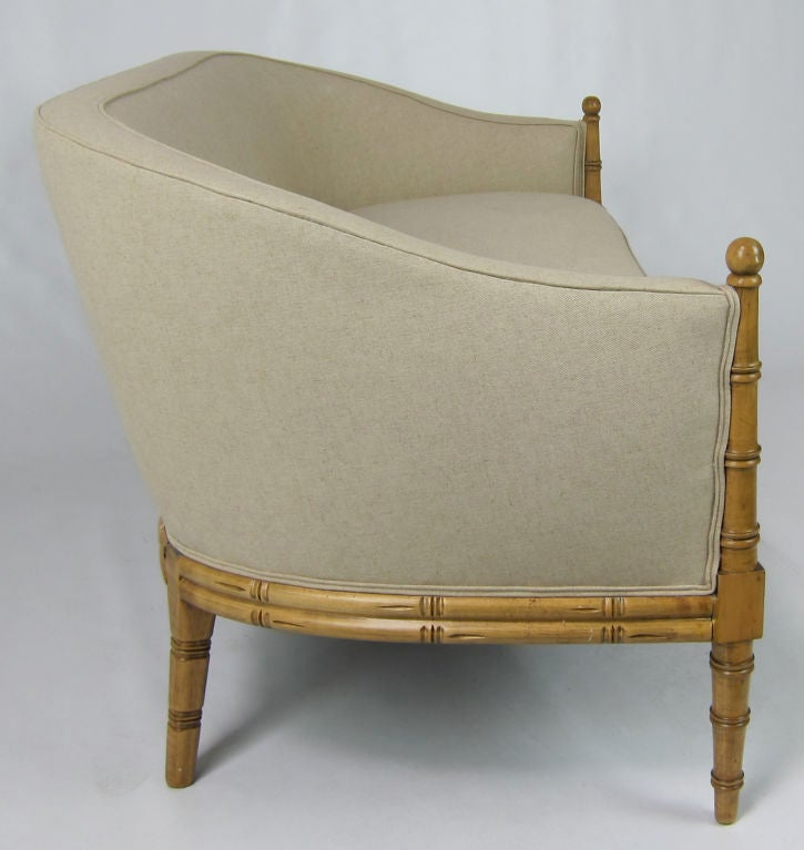 Elegant Regency style faux Bamboo framed Settee freshly refinished and reupholstered in Belgian Linen.
