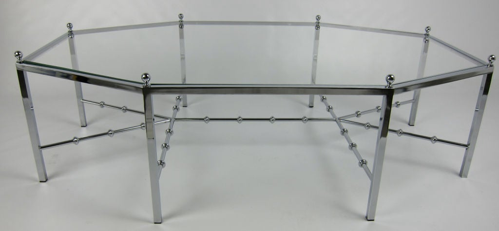 Beautifully crafted Neo-Regency Elongated Octagonal Chrome Coffee Table with Faux Bamboo stretchers and inset glass top.  Chrome ball finials.