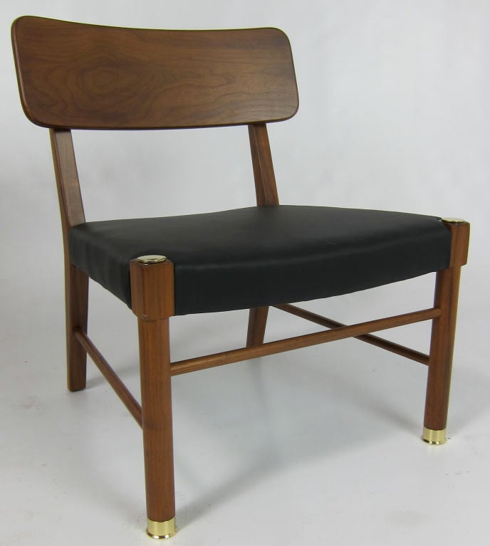Set of four Teak Lounge chairs.  Refinished and reupholstered.