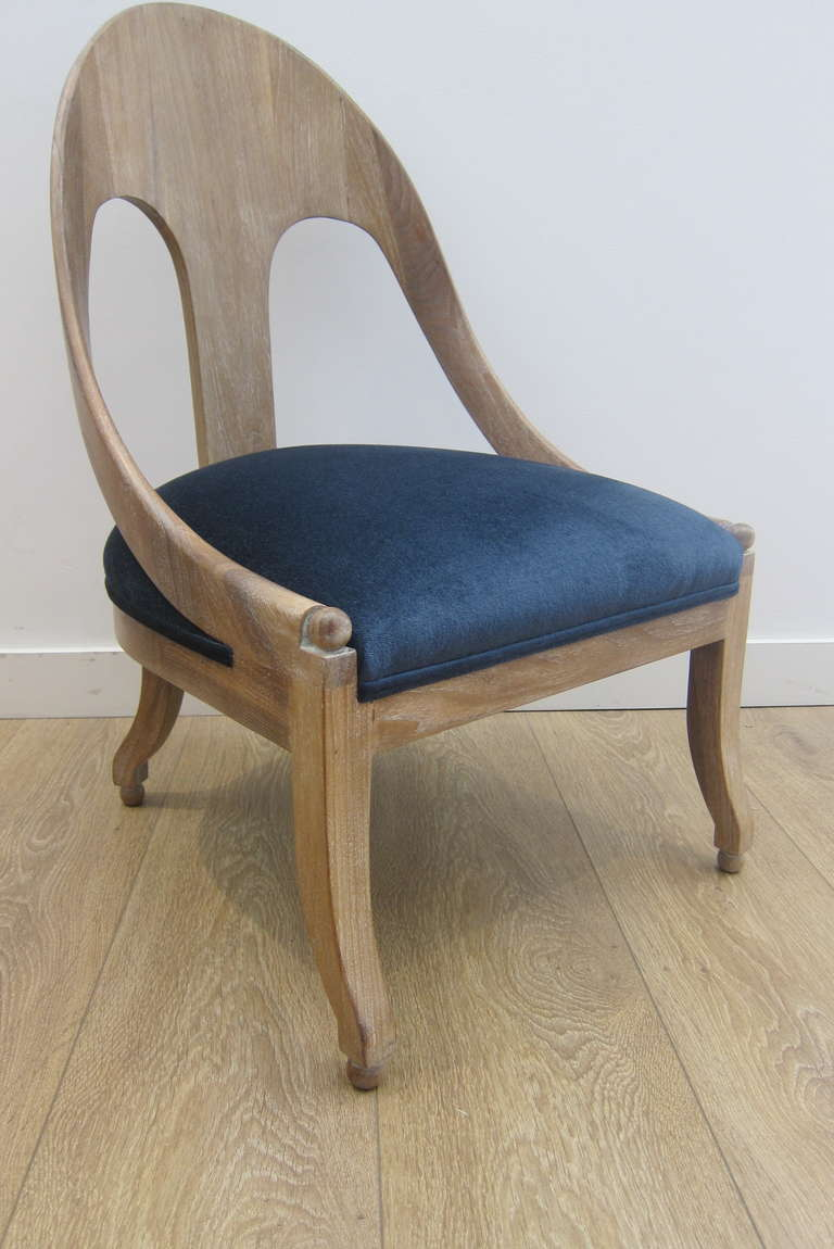 A vintage cerused finish spoon back chair newly upholstered with a blue velvet.