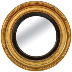 A French Neoclassic Early 19th Century Round Giltwood, Gilt-Gesso, and Ebonized Mirror