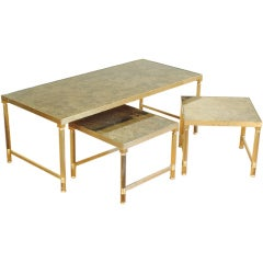 A Set of Brass and Tinted Mirrored Glass Cocktail Tables