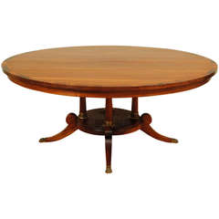 A Very Large English Regency Style Round Mahogany Dining Table