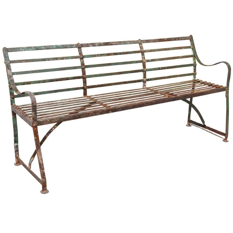 A Turn Of The Century Painted Wrought And Cast Iron Garden Bench
