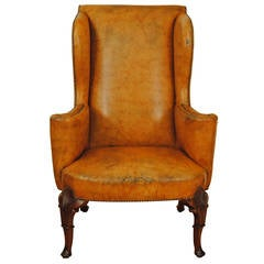 Carved Walnut Georgian Style Leather Upholstered Wing Chair