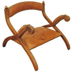 "A Portuguese Low Mahogany and Leather Upholstered ""Saddle Chair"""