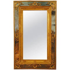 Italian Regence Period Carved Giltwood and Embossed Gilt Gesso Mirror