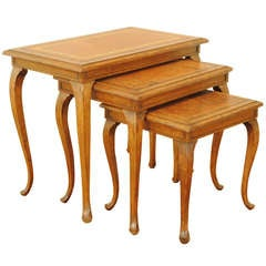 A Set of 3 Louis XV Style Oak and Leather Covered Nesting Tables