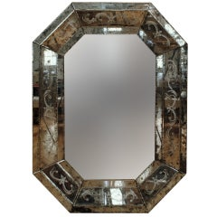 An Antique Glass Elongated Octagonal Etched and Bevelled Venetian Mirror
