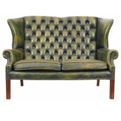 An English Mahogany and Leather Upholstered Sofa