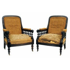 A Pair of English Carved Mahogany and Walnut Victorian Armchairs