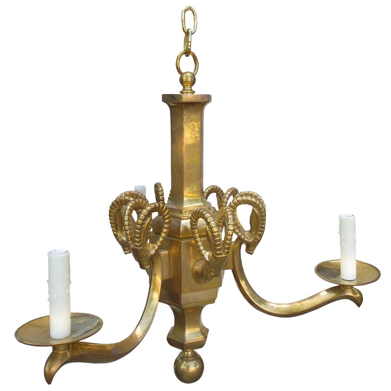 Mid-20th Century Champan Brass Three-Arm Chandelier with Ram's Heads