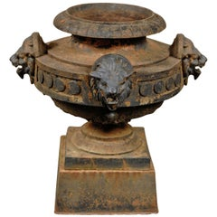 19th Century Iron Garden Urn with Lions Heads on Plinth