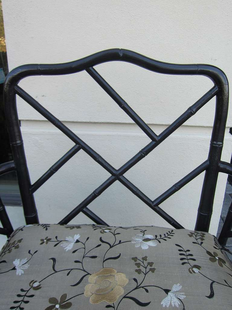 Pair of 19th Century Regency Style Ebonized Bamboo Arm Chairs, Cane Seats with cushions Elegant