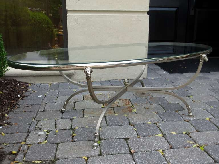 Midcentury neoclassical steel and silver plated oval coffee table.