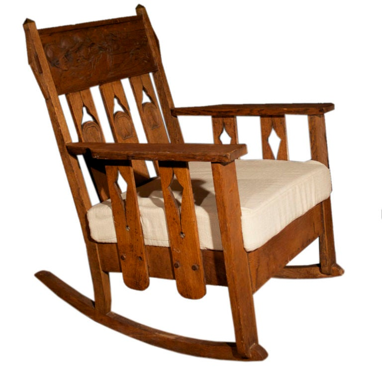 Arts and crafts carved oak rocking chair