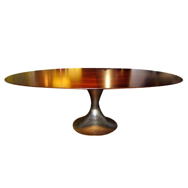 fabulous oval rosewood dining table with hammered metal
